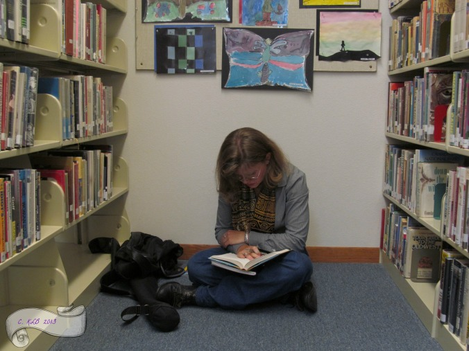 Hiding in the non-fiction. My favorite spot in all the library.