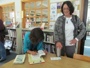 Susan signing her book Poemcrazy